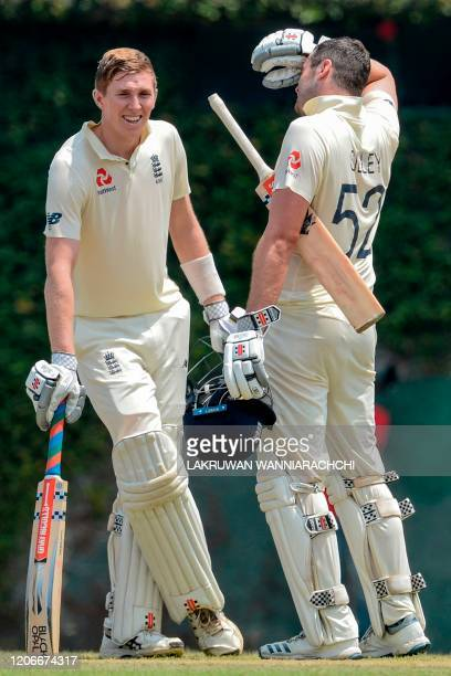 England's Zak Crawley and Dom Sibley takes a rest during the opening day of a fourday practice match between Sri Lanka Board President's XI and...
