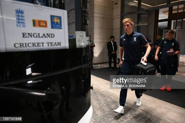 England's Zak Crawley boards a bus for the airport in Colombo on March 14 2020 England's cricket team abruptly pulled out of a tour of Sri Lanka on...
