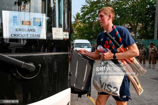 England's Zak Crawley boards the bus after the Test series against Sri Lanka was postponed at the P Sara Oval Cricket Stadium in Colombo on March 13...