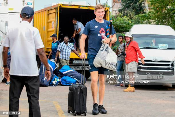 England's Zak Crawley carrying a luggage walks to the bus after the Test series against Sri Lanka was postponed at the P Sara Oval Cricket Stadium in...