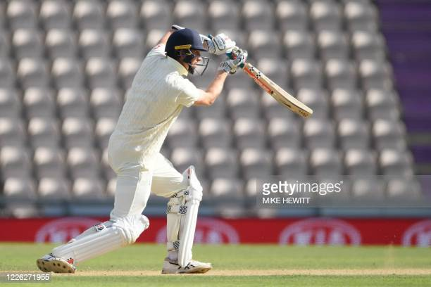 England's Zak Crawley drives the ball on the fourth day of the first Test cricket match between England and the West Indies at the Ageas Bowl in...