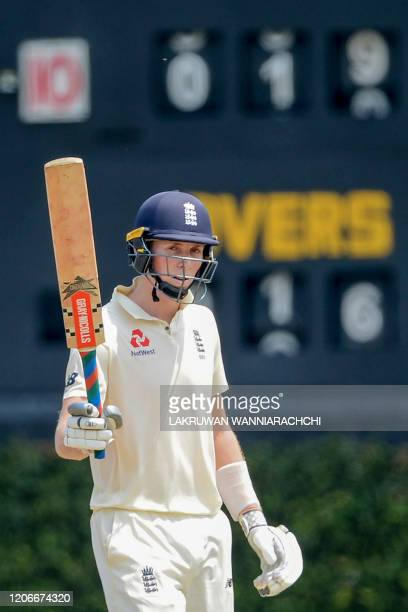 England's Zak Crawley raises his bat after scoring a halfcentury during the opening day of a fourday practice match between Sri Lanka Board...