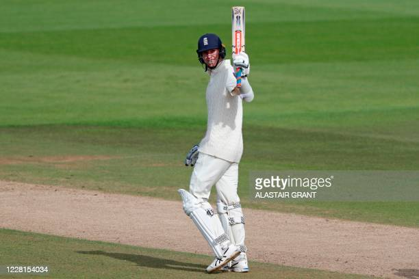 England's Zak Crawley reacts to reaching 250 on the second day of the third Test cricket match between England and Pakistan at the Ageas Bowl in...