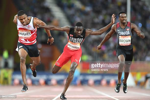 Englands Zharnel Hughes Trinidad And Tobagos Jereem Richards and Canada's Aaron Brown compete in the athletics men's 200m final during the 2018 Gold...