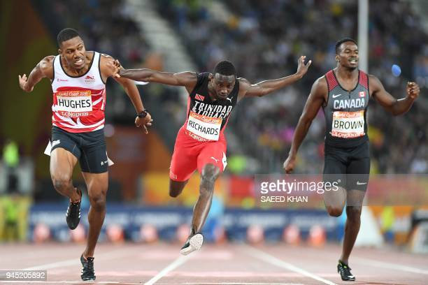 TOPSHOT Englands Zharnel Hughes Trinidad And Tobagos Jereem Richards and Canada's Aaron Brown cross the finish line of the athletics men's 200m final...