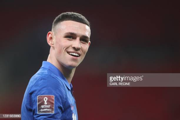 Englands's midfielder Phil Foden gestures during the FIFA World Cup Qatar 2022 qualification football match between England and San Marino at Wembley...