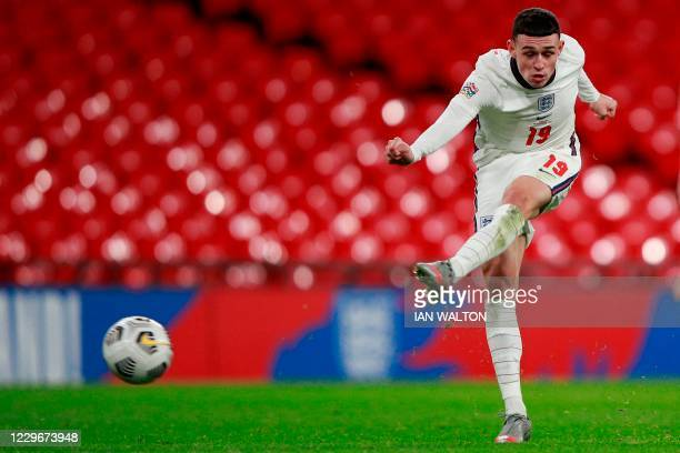 Englands's midfielder Phil Foden shoots to score his teams fourth goal during the UEFA Nations League group A2 football match between England and...