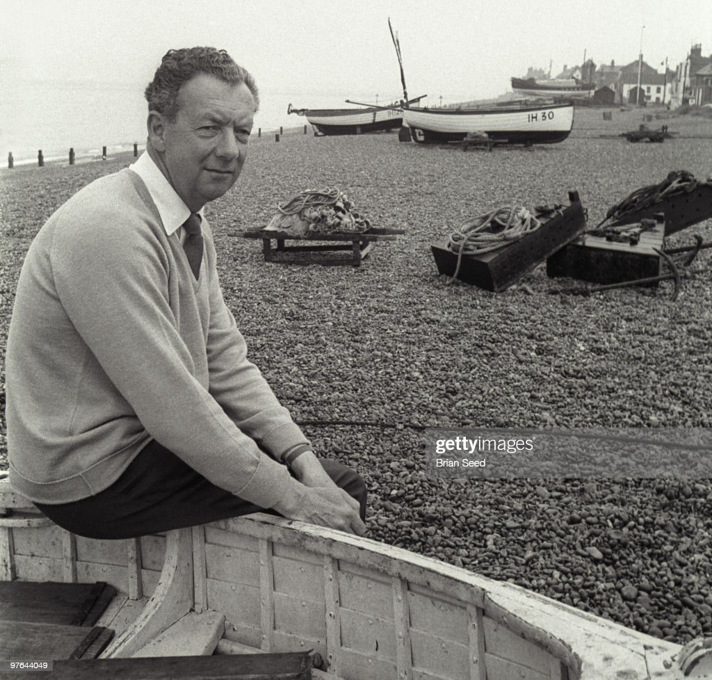 England,Suffolk,Aldeburgh,Benjamin Britten at seashore sitting on edge of fisherman's boat