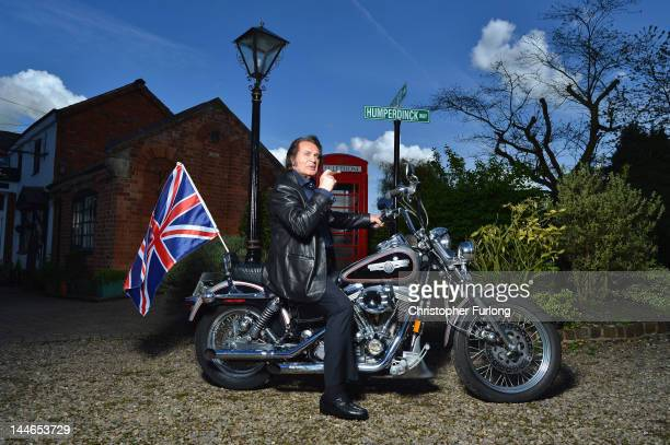 Englebert Humperdinck poses at his home for photographs on his Harley Davidson with a Union flag before he travels to Baku for Eurovision on May 8...