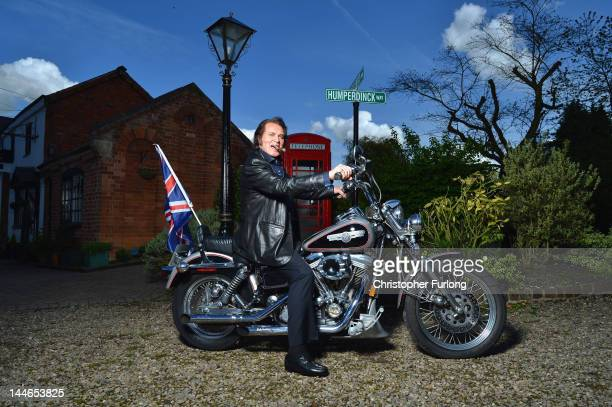Englebert Humperdinck poses for photographs on his Harley Davidson with a Union flag before he travels to Baku for Eurovision on May 8 2012 in...
