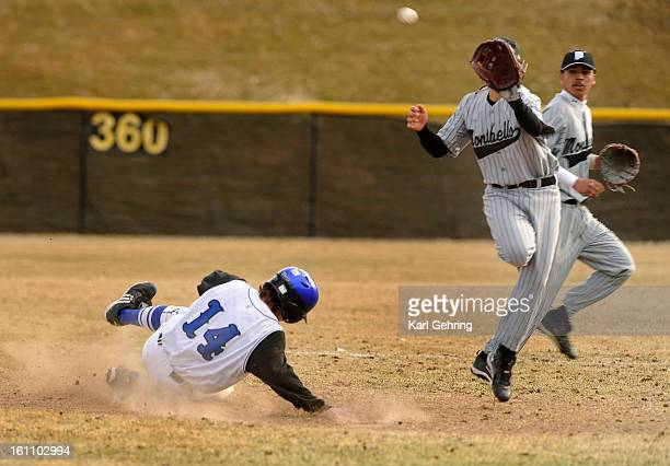 Englewood baserunner Steven Ross took second base on a high throw from catcher Isiah Easter to 2B Alfredo Herrera The Englewood High School baseball...