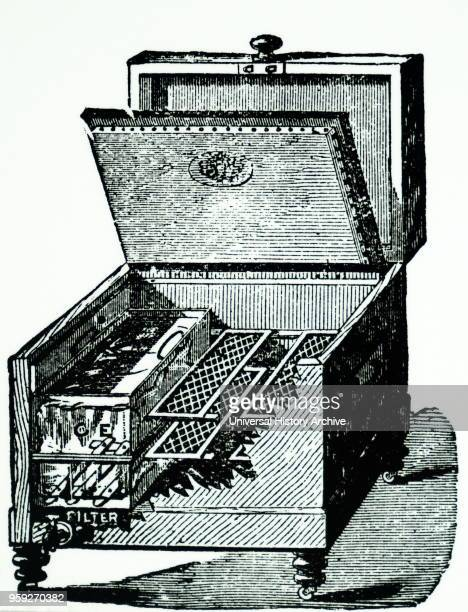 English 20th century illustration of a refrigerator showing compartments for Ice and Food From Mrs Beeton's book of Household Management 1901