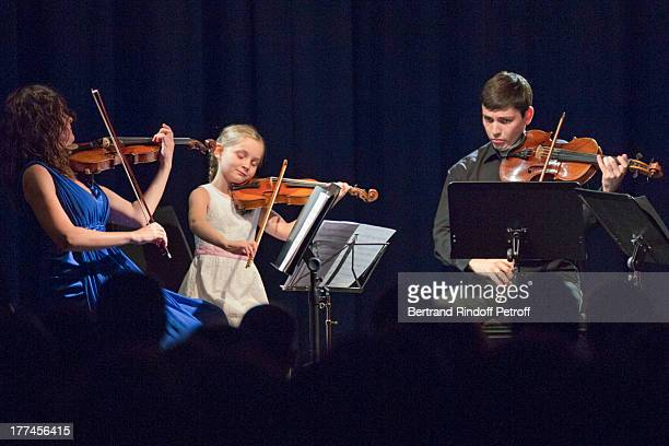 English 8yearold violin prodigy Alma Deutscher performs a piece of her own composition alongside violonists Michael Rudoy and Julia Igonina from the...
