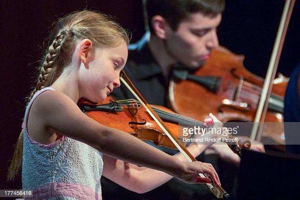English 8yearold violin prodigy Alma Deutscher performs a piece of her own composition alongside violonist Michael Rudoy from the New Russian Quartet...