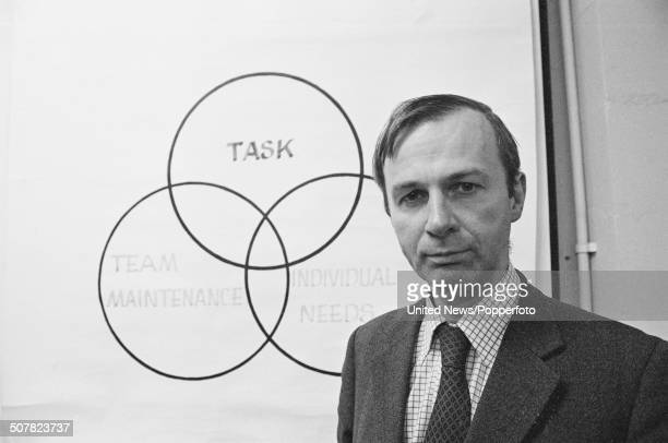 English academic and professor of Leadership Studies at the University of Surrey John Adair posed in front of a Venn diagram at the University in...