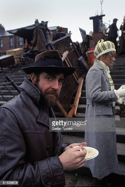English actor Alan Bates on the set of Ken Russell's 'Women in Love' adapted from the novel by D H Lawrence November 1968 Behind him is his costar...