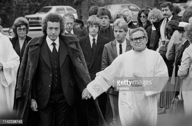 English actor Alan Lake holding hands with a bishop and his son Jason Lake attend the funeral of Diana Dors in Sunningdale Berkshire UK 11th May 1984