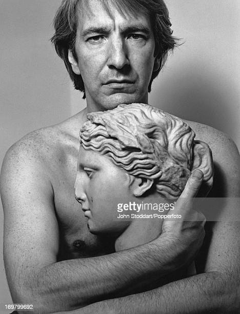English actor Alan Rickman poses barechested 1991