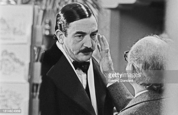 English actor Albert Finney as fictional Belgian detective Hercule Poirot on the set of the Agatha Christie film 'Murder on the Orient Express', UK,...