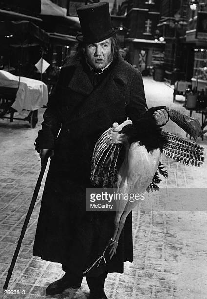 English actor Albert Finney playing the part of Scrooge during the filming of the musical 'Scrooge' adapted from the story 'A Christmas Carol' by...
