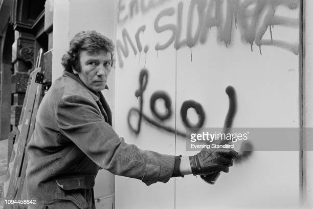 English actor Albert Finney writing on a wall with a spray can UK 3rd March 1975 He is directing a revival of the play 'Loot' as part of the Joe...