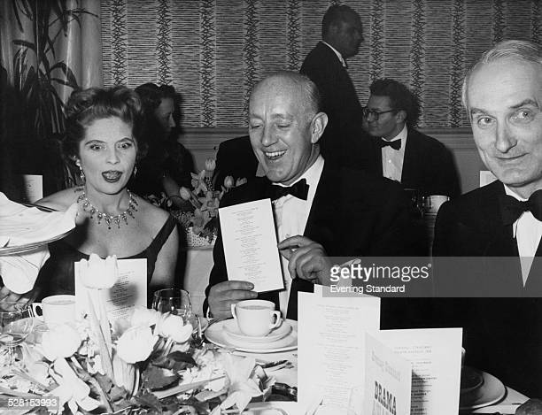 English actor Alec Guinness with American actress Dorothy Hyson at the Evening Standard theatre awards London 27th January 1959