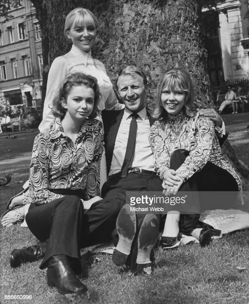 English actor Alfred Burke with actresses Pauline Challoner , Deborah Grant and Tessa Wyatt , in Soho Square, London, 14th July 1969. They are at a...