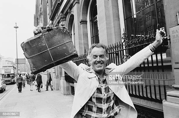 English actor and campaigner Brian Rix pictured holding an ancient briefcase outside the Whitehall Theatre in London on 3rd August 1976 Rix is...