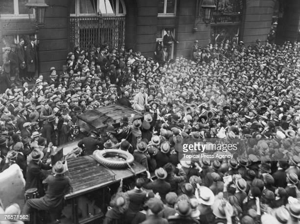 English actor and comedian Charlie Chaplin arrives at the Ritz Hotel in Piccadilly and is greeted by a horde of ardent admirers September 1921