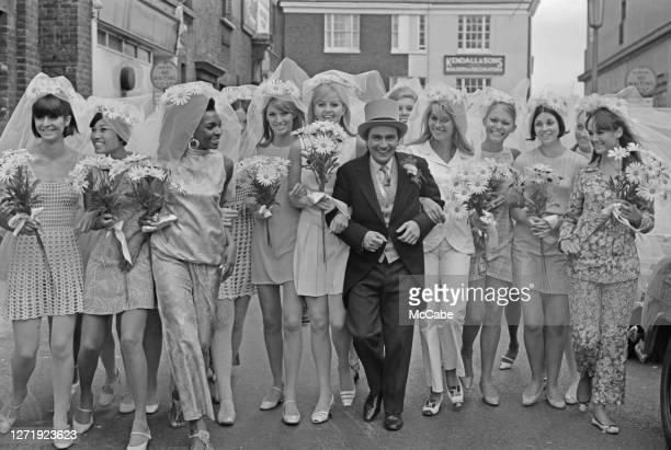 English actor and comedian Dudley Moore with some of his costars dressed as brides during the filming of '30 is a Dangerous Age Cynthia' UK July 1966