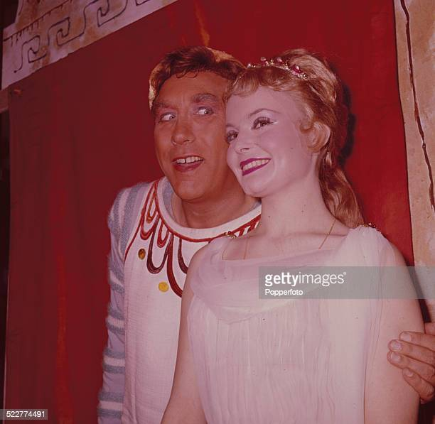English actor and comedian Frankie Howerd posed backstage with actress Isla Blair during rehearsals for the musical 'A Funny Thing Happened on the...