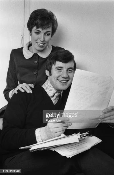 English actor and comedian Michael Palin reads a script with his wife Helen Gibbins in London in February 1968 Michael Palin currently writes for and...