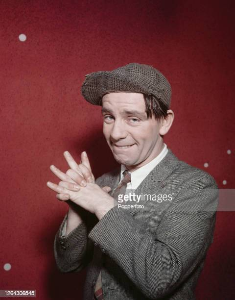 English actor and comedian Norman Wisdom posed at home in South Mimms Hertfordshire England in June 1954