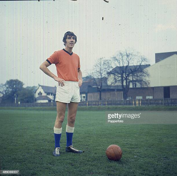English actor and comedian Peter Cook dressed in football kit stands with a football on a pitch in 1968