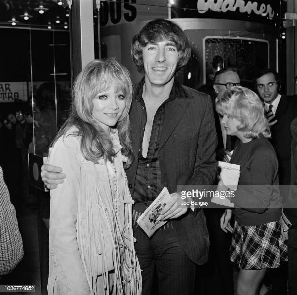 English actor and comedian Peter Cook pictured with actress Judy Huxtable at the premiere of the film 'The Rise and Rise of Michael Rimmer' at a...