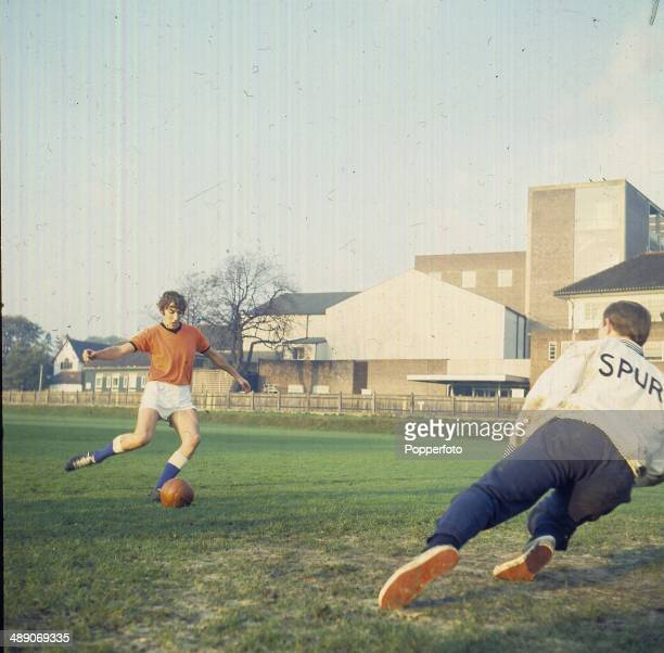 English actor and comedian Peter Cook plays a game of football with Tottenham Hotspur goalkeeper Pat Jennings in 1968