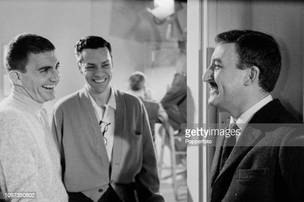 English actor and comedian Peter Sellers pictured on right with American film director Blake Edwards as they share a joke during a break in shooting...