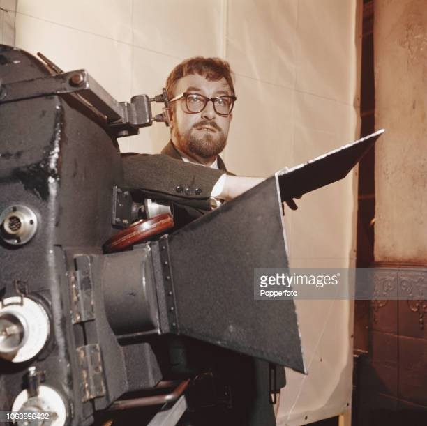 English actor and comedian Peter Sellers pictured standing next to a movie camera at MGM British Studios in Borehamwood, England in 1960. Peter...