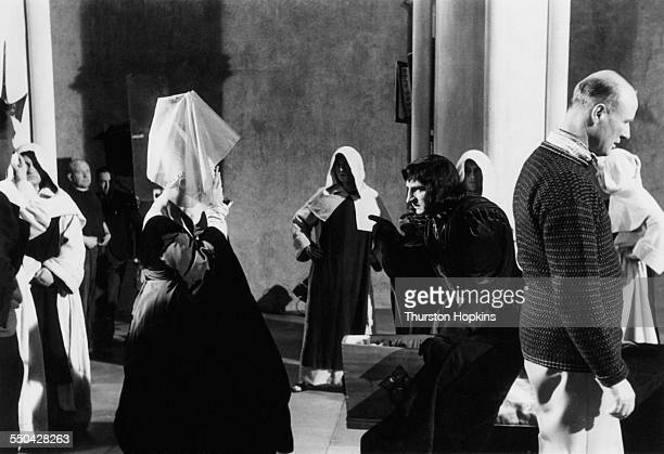 English actor and director Laurence Olivier as Richard Duke of Gloucester on the set of his adaptation of William Shakespeare's 'Richard III'...