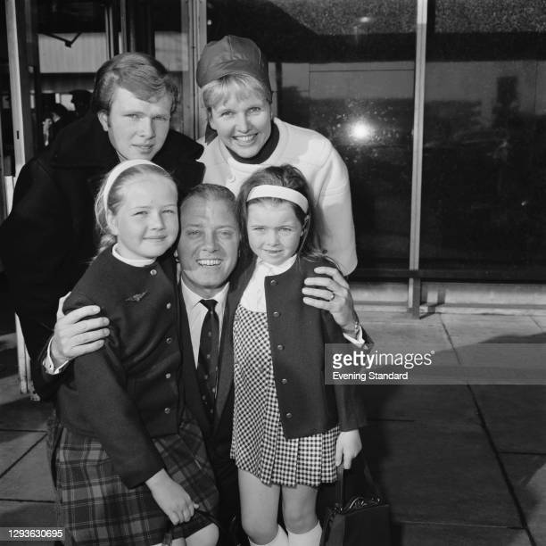 English actor and director Richard Attenborough with his family at London Airport, UK, 2nd August 1966. Richard and his wife, actress Sheila Sim are...