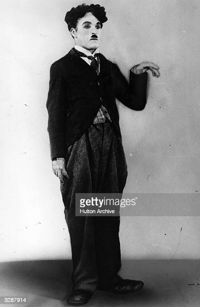 English actor and director Sir Charles Spencer Chaplin plays his classic role as the little tramp in the film 'The Circus' directed by himself for...