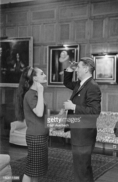 English actor and director Sir Michael Redgrave with operatic soprano Helia T'Hezan in the Organ Room of Glyndebourne East Sussex 8th May 1966 They...