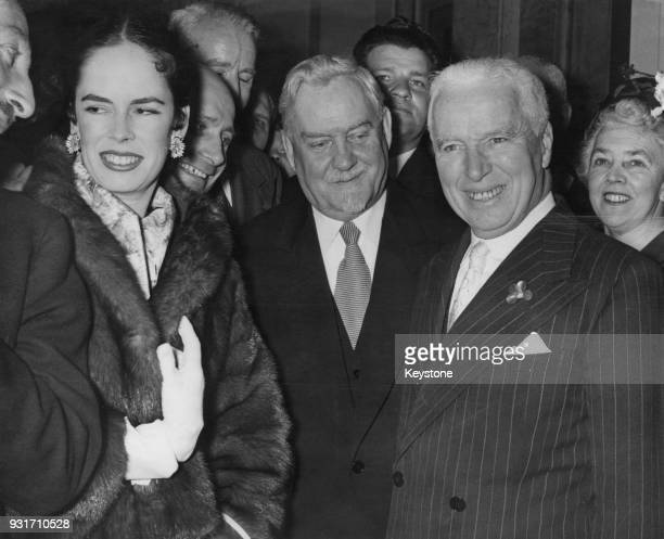 English actor and filmmaker Charlie Chaplin and his wife Oona pose with Soviet politician Nikolai Bulganin at a reception at Claridge's Hotel in...