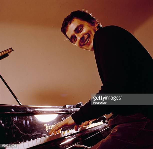 English actor and musician Dudley Moore plays a Bosendorfer piano in 1966