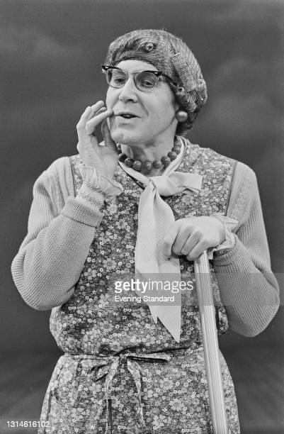 English actor and playwright Alan Bennett dressed for his role as Mrs Swabb, a cleaner, in his play 'Habeas Corpus', UK, February 1974.