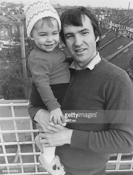 English actor and radio presenter Larry Lamb at his home in Fulham London with his son George 18th March 1981 George later followed his father into...