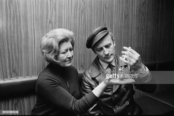 English actor and singer Edward Woodward with 'polished stone' jewelry, UK, 19th November 1971.