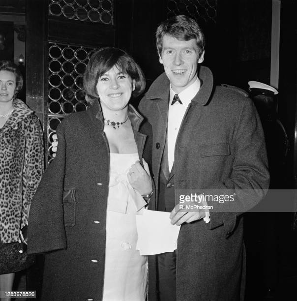 English actor and singer Michael Crawford with his wife Gabrielle Lewis at the premiere of the film 'Judith' in London, UK, 17th February 1966.