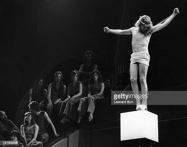 English actor and singer Paul Nicholas plays the crucified messiah in the musical 'Jesus Christ Superstar', on stage at the Palace Theatre, London,...