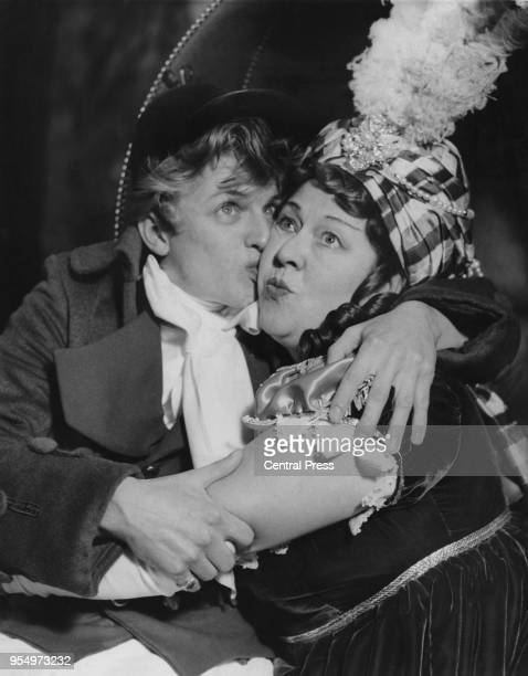 English actor and singer Tommy Steele as Tony Lumpkin with actress Peggy Mount as Mrs Hardcastle during rehearsals for the Oliver Goldsmith play 'She...